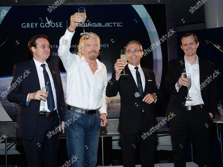 Bacardi global category director Ben Farlow, left, Virgin Group founder Richard Branson, Grey Goose Maitre de Chai, Francois Thibault and Virgin Galactic CEO George Whitesides share a toast at the Grey Goose Vodka and Virgin Galactic global partnership announcement event at the Rose Center for Earth & Space, in New York