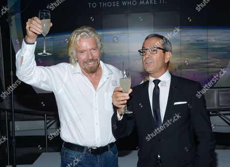 Virgin Group founder Richard Branson, left, toasts Grey Goose Maitre de Chai, Francois Thibault, at the Grey Goose Vodka and Virgin Galactic global partnership announcement event at the Rose Center for Earth & Space, in New York