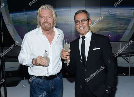 Virgin Group founder Richard Branson, left, toasts Grey Goose Maitre de Chai, Francois Thibault, attend the Grey Goose Vodka and Virgin Galactic global partnership announcement event at the Rose Center for Earth & Space, in New York
