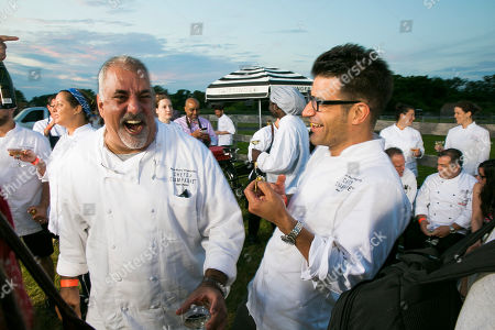 Stock Picture of Chef Sam Hazen and Chef George Mendes seen at James Beard Foundation's Chefs & Champagne at Wolffer Estate on in Sagaponack, N.Y