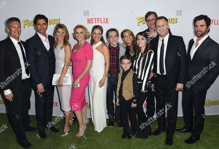 """From left, Jeff Franklin, John Stamos, Lori Loughlin, Jodie Sweetin, Andrea Barber, Chief Content Officer of Netflix -Ted Sarandos, Michael Campion, Candace Cameron Bure, Elias Harger, Soni Bringas, Bob Saget, Dave Coulier and Juan Pablo Di Pace attend the premiere of """"Fuller House"""" on in Los Angeles"""
