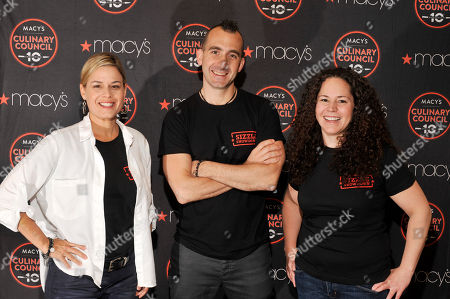 Macy's Culinary Council Chefs Cat Cora, Marc Forgione and Stephanie Izard pose for a photo during the Macy's Great American Grilling Guru contest at Macy's Lenox Square, in Atlanta. The winner received a $10,000 check and a trip to New York City for the Macy's 4th of July Fireworks Show