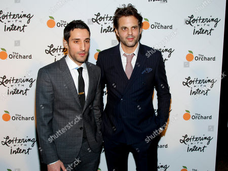 """Michael Godere, left, and Ivan Martin, right, attend the premiere of """"Loitering With Intent"""" at the SVA Theater, in New York"""