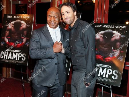 """Stock Photo of Mike Tyson, left, and Bert Marcus, right, attend a special screening of """"Champs"""" at the Village East Cinema, in New York"""