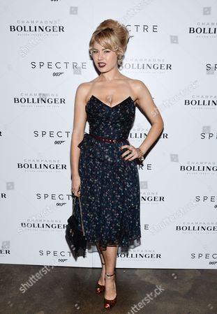 """Stock Photo of Model Gia Genevieve attends a pre-release special screening of """"Spectre"""", hosted by Champagne Bollinger with The Cinema Society, at the IFC Center, in New York"""