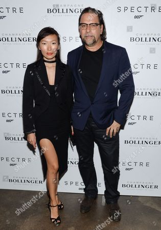 """Stock Image of Enga Purevjav, left, and Sante D'Orazio attend a pre-release special screening of """"Spectre"""", hosted by Champagne Bollinger with The Cinema Society, at the IFC Center, in New York"""