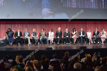"Gabourey Sidibe and from left, Evan Peters, Denis O'Hare, Frances Conroy, Brad Falchuk, Sarah Paulson, Ryan Murphy, Kathy Bates, Angela Bassett, Tim Minear, Emma Roberts, Dante Di Loreto and Jamie Brewer speak at a panel at PALEYFEST 2014 - ""American Horror Story: Coven"" at the Kodak Theatre, in Los Angeles"