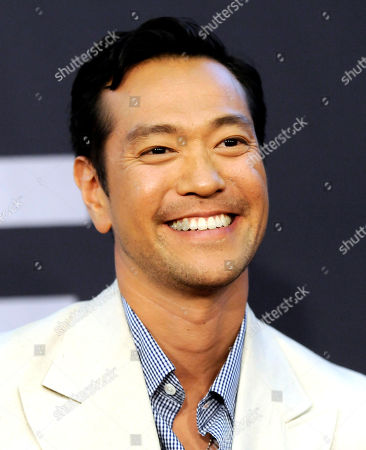"""Stock Picture of Actor Louis Ozawa Changchien attends the world premiere of """"The Bourne Legacy"""" at the Ziegfeld Theatre on in New York"""