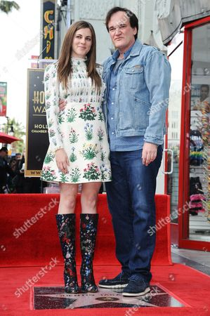 Quentin Tarantino, right, and Courtney Hoffman attend a ceremony honoring Tarantino with a star on the Hollywood Walk of Fame, in Los Angeles