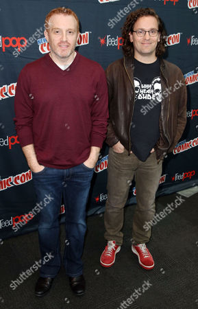 """Jonathan E. Steinberg, left, and Robert Levine, from the STARZ original series """"Black Sails"""", pose for a photo at New York Comic Con on in New York"""