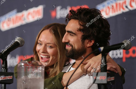 """Gregg Chillin, right and Laura Haddock, from """"Da Vinci's Demons"""", are seen during the STARZ panel at New York Comic Con on in New York"""