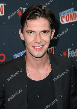 """Toby Schmitz, from the STARZ original series """"Black Sails"""", poses for a photo at New York Comic Con on in New York"""
