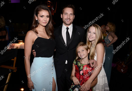 Nina Dobrev, from left, Peter Facinelli, Fiona Eve Facinelli, and Lola Ray Facinelli pose backstage at the Television Academy's Creative Arts Emmy Awards at Microsoft Theater, in Los Angeles