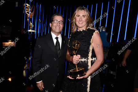 Nancy Dubuc poses backstage at the Television Academy's Creative Arts Emmy Awards at Microsoft Theater, in Los Angeles