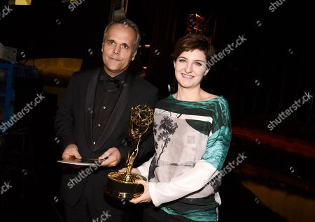 Dirk Wilutzky, left, and Mathilde Bonnefoy poses backstage at the Television Academy's Creative Arts Emmy Awards at Microsoft Theater, in Los Angeles