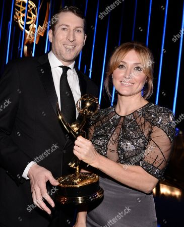 Scott Aukerman, left, and Sasha Alexander pose backstage at the Television Academy's Creative Arts Emmy Awards at Microsoft Theater, in Los Angeles