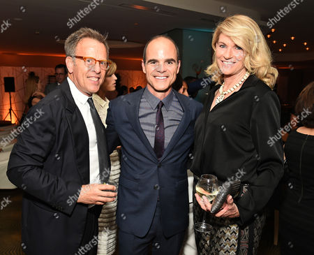 Stock Image of Mark Johnson, from left, Michael kelly and Lezlie Johnson attend the Television Academy's 67th Emmy Awards Performers Nominee Reception at the Pacific Design Center on Saturday, Sept.19, 2015, in West Hollywood, Calif