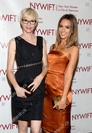 Stock Image of Actress Jessica Alba, right, and honoree, makeup artist Evelyne Noraz, attend the New York Women in Film & Television Honors gala at the McGraw-Hill Building, in New York