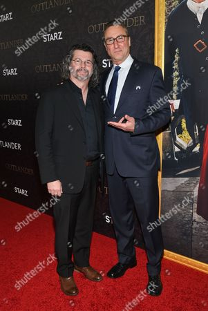 """Creator and executive producer Ronald D. Moore, left, and Starz Managing Director Carmi Zlotnik attend the """"Outlander"""" Book Two World Premiere and After Party at the American Museum of Natural History, in New York"""