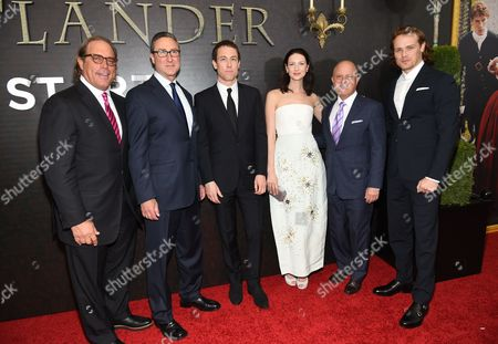 "Sony Pictures Television Chairman Steve Mosko, left, Starz Managing Director Carmi Zlotnik, actor Tobias Menzies, left, actress Caitriona Balfe, Starz CEO Chris Albrecht and actor Sam Heughan attend the ""Outlander"" Book Two world premiere and after party at the American Museum of Natural History, in New York"
