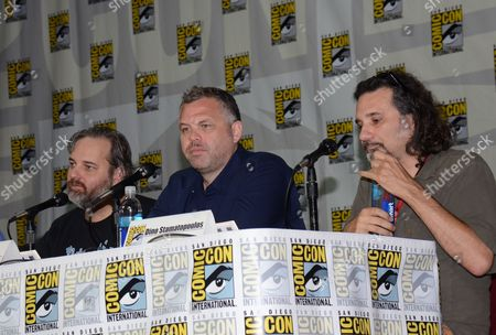 """Dan Harmon and from left, Chris McKenna and Dino Stamatopoulos attend the """"Community"""" panel on Day 1 of Comic-Con International, in San Diego"""