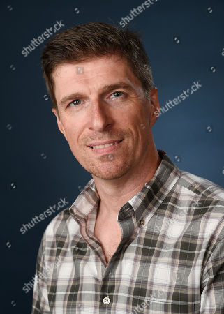 "Chuck Hogan, co-creator, executive producer and writer of ""The Strain,"" poses for a portrait during the 2016 Television Critics Association Summer Press Tour at the Beverly Hilton, in Beverly Hills, Calif"