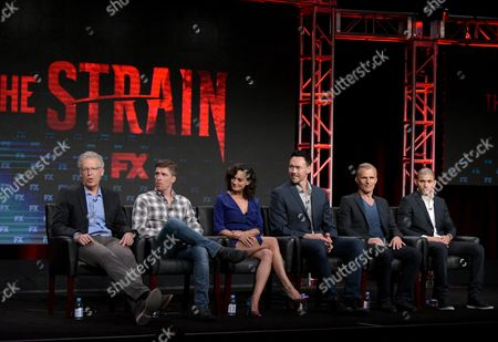 "Stock Image of Carlton Cuse, executive producer/director/writer, from left, Chuck Hogan, executive producer/co-creator/writer, and actors Natalie Brown, Kevin Durand, Richard Sammel and Miguel Gomez participate in ""The Strain"" panel during the FX Television Critics Association summer press tour, in Beverly Hills, Calif"
