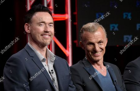 "Kevin Durand, left, and Richard Sammel participate in ""The Strain"" panel during the FX Television Critics Association summer press tour, in Beverly Hills, Calif"