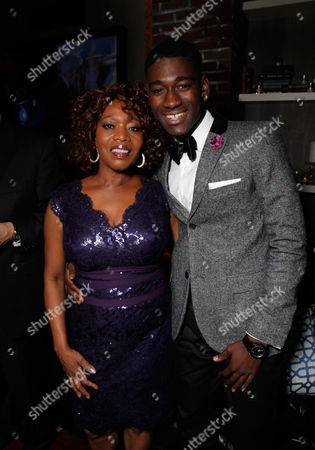 Alfre Woodward, left, and Kwame Boateng attend the FOX after party for the 71st Annual Golden Globes award show on in Beverly Hills, Calif