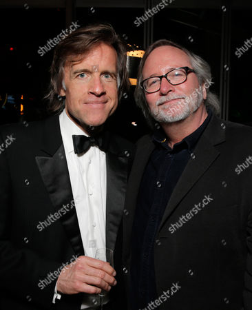Bill Pohlad, left, and Sean Bobbitt attend the FOX after party for the 71st Annual Golden Globes award show on in Beverly Hills, Calif
