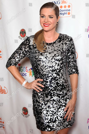Stock Photo of Sonya Smith arrives at the Amigos For Kids ING Miami Celebrity Domino Night! on Saturday, June, 15, 2013 at Jungle Island in Miami, Fl
