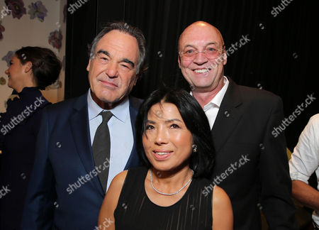 """Director Oliver Stone, Sun-jung Jung and Producer Moritz Borman are seen at Audi and Nespresso co-host the official pre-party for Open Road Films' """"Snowden"""" at 2016 Toronto International Film Festival, in Toronto"""