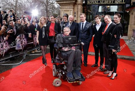 Actress Jessica Chastain from left to right, Producer Emma Thomas, Professor Brian Cox, Professor Stephen Hawking (front centre) Professor Kip Thorne, Director Christopher Nolan, Jack Zimmer, Hans Zimmer and Zoe Zimmer pose for photographers upon arrival for the Interstellar Live show at the Royal Albert Hall in central London, Monday, 30 March, 2015. Christopher Nolan's film will be shown on the big screen, whilst composer Hans Zimmer leads a 60-piece orchestra and the Hall's Grand Organ in a simultaneous performance of the movie's Academy and BAFTA nominated score