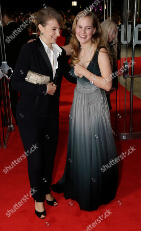 Actresses Anamaria Marinca and Alicia Von Rittberg pose for photographers at the premiere for the film Fury, which closes the BFI London Film Festival, at the Odeon cinema in central London