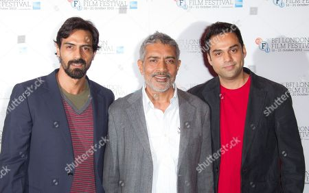 Director Prakash Jha, centre, stands with actors Abhay Deol and Arjun Rampal, left, at a photocall for Prakash Jha's 'Chakravyah' during the London Film Festival at The Empire cinema, Leicester Square on in London, UK