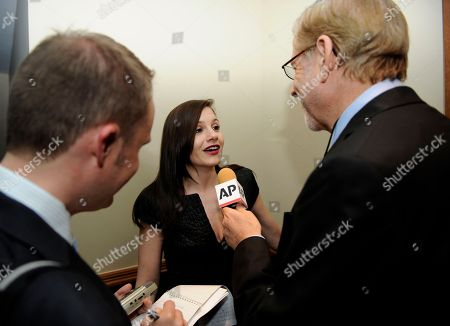 "Songwriter/producer and former ""American Idol"" judge Kara DioGuardi, center, is interviewed at the Grammy's on the Hill Awards at The Hamilton on in Washington"