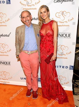 Artist Peter Max, left, and fashion model Petra Nemcova, right, attend the Happy Hearts Fund Gala, in New York