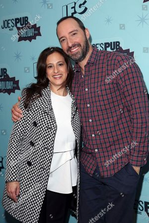 """IFC president Jennifer Caserta, left, and Tony Hale attend IFC's """"Joe's Pub Presents: A Holiday Special"""" at Joe's Pub in The Public Theater, in New York"""