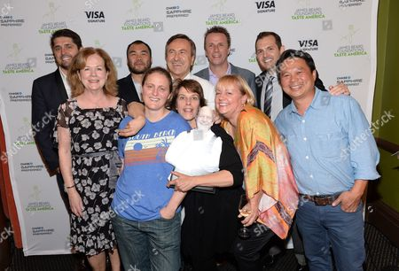 """Chefs, from left, Ludo Lefebvre, Paul Qui, April Bloomfield, Daniel Boulud, Barbara Lynch, Marc Murphy, Sherry Yard and Charles Phan pose with James Beard Foundation president Susan Ungaro, far left, and business director Chase Sapphire Preferred Jeff Bedard, back right, at the kick-off event for the James Beard Foundation's """"Taste America"""" national epicurean tour presented by Chase Sapphire Preferred Visa Signature at the James Beard House on in New York"""