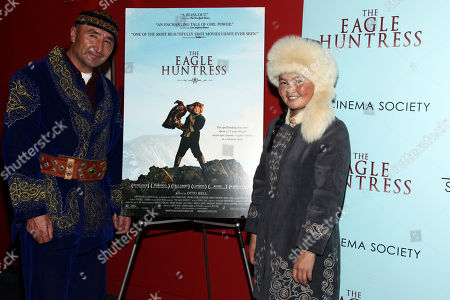 """Nurgaiv Rys, left, and Aisholpan, right, attend a special screening of """"The Eagle Huntress"""" at the Landmark Sunshine Cinema, in New York"""