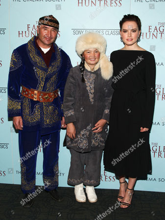 """Nurgaiv Rys, from left, Aisholpan and Daisy Ridley attend a special screening of """"The Eagle Huntress"""" at the Landmark Sunshine Cinema, in New York"""