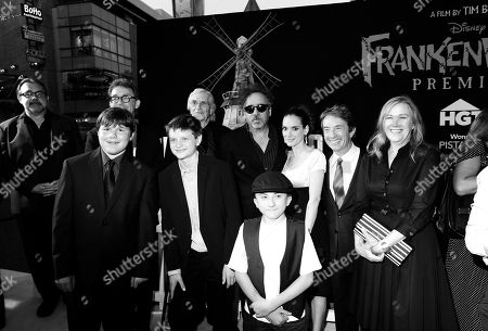 DISNEY: From left, Don Hahn, Robert Capron, Tom Kenny, Charlie Tahan, Martin Landau, Tim Burton, Atticus Shaffer, Winona Ryder, Martin Short and Catherine O'Hara arrive at the premiere of Disney's stop-motion animated full length black and white film 'Frankenweenie' directed by Tim Burton, in Los Angeles