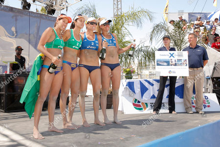 Taiana Lima and Talita Antunes of Brazil and Jennifer Kessy and April Ross of USA pose at Celebrity Cruises' Taste of Modern Luxury Culinary & Spa Tour at World Series of Beach Volleyball Finals on in Long Beach, Calif