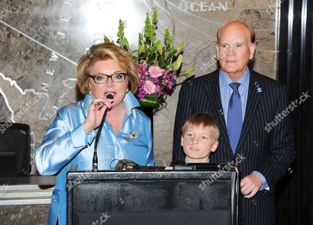 """Autism Speaks"""" co-founder Suzanne Wright, left, grandson Mattais Hildebrand, and """"Autism Speaks"""" co-founder Bob Wright attend Empire State Building autism awareness month lighting on in New York"""