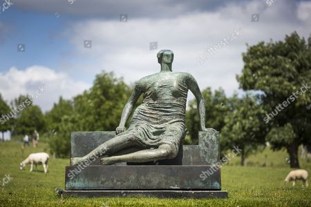 File picture taken 09/07/2015 show the old flo sculpture at Yorkshire Sculpture Park. Henry Moore's sculpture Draped Seated Woman 1957, affectionately known as 'Old Flo' is being removed from the Yorkshire Sculpture park today after 20 years on public display at the park. The iconic sculpture was loaned to YSP by the London Borough of Tower Hamlets in 1997, after the Stifford Estate in Stepney where it had been located since 1962 was demolished. The sculpture will be returning to Tower Hamlets to be sited in a new home in Cabot Square, Canary Wharf. The return of the sculpture to London marks an end to a bitter political battle over Old Flo. In 2012 the disgraced former mayor of Tower Hamlets Lutfur Rahman, declared that it should be sold to raise £20m, that sparked protests & a court battle over who actually owned the sculpture. Tower Hamlets was confirmed as the legal owner in 2015.