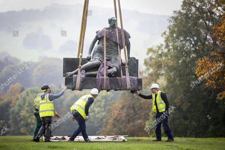 Stock Photo of Henry Moore's sculpture Draped Seated Woman 1957, affectionately known as 'Old Flo' is being removed from the Yorkshire Sculpture park today after 20 years on public display at the park. The iconic sculpture was loaned to YSP by the London Borough of Tower Hamlets in 1997, after the Stifford Estate in Stepney where it had been located since 1962 was demolished. The sculpture will be returning to Tower Hamlets to be sited in a new home in Cabot Square, Canary Wharf. The return of the sculpture to London marks an end to a bitter political battle over Old Flo. In 2012 the disgraced former mayor of Tower Hamlets Lutfur Rahman, declared that it should be sold to raise £20m, that sparked protests & a court battle over who actually owned the sculpture. Tower Hamlets was confirmed as the legal owner in 2015.