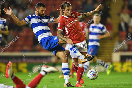 Stock Photo of Barnsley's George Moncur is tackled by Steven Caulker.