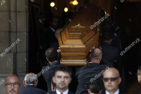 Men carry the coffin during the funeral ceremony of the late French businesswoman Liliane Bettencourt inside Saint-Pierre church in Neuilly sur Seine, near Paris, France, 26 September 2017. Bettencourt, the heiress of cosmetics giant L'Oreal and daughter of the company's founder, has died on 21 September 2017. She was 94.