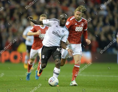 Aboubakar Kamara of Fulham and Matthew Mills of Nottingham Forest during the Sky Bet Championship match at the City Ground, Nottingham