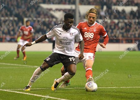 Sheyi Ojo of Fulhamand Matthew Mills of Nottingham Forest during the Sky Bet Championship match at the City Ground, Nottingham